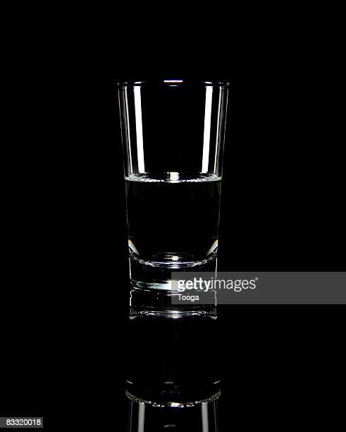 half a glass of water - half full stock photos and pictures
