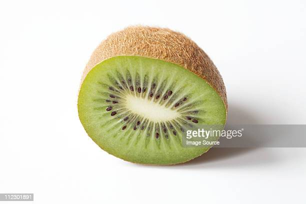 Half a kiwi on white background