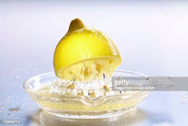 Half a lemon on lemon squeezer