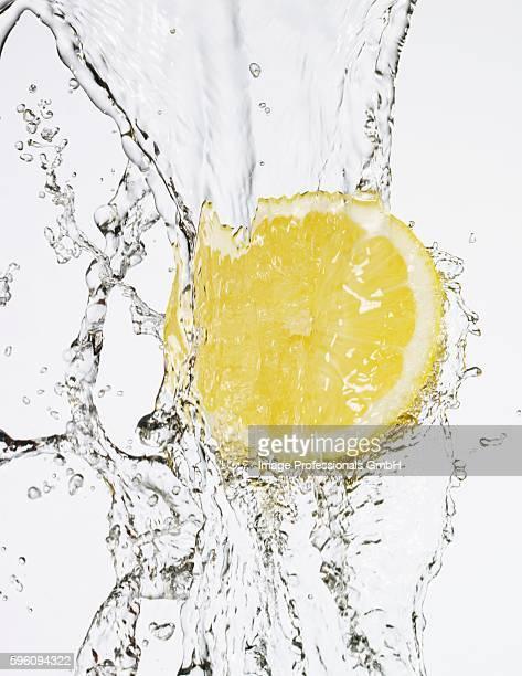 Half a lemon under flowing water