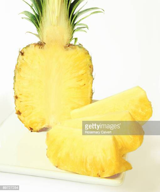 Half a pineapple with four sections, close up.