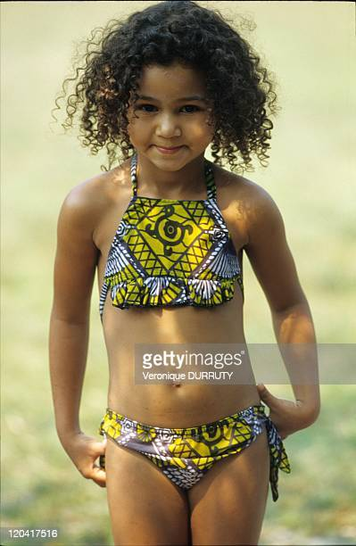 Half Blood Little Girl In Swimsuit In Congo