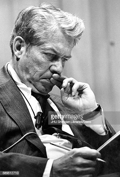 A half body portrait of editor in chief of Time Inc Hedley Donovan concentrating on what he is reading at the American University Symposium...