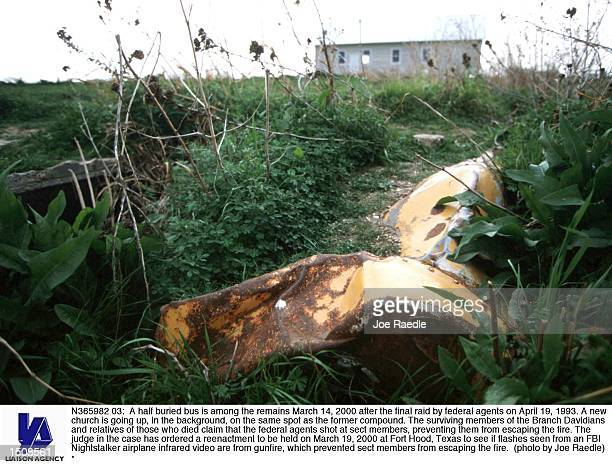 A half buried bus is among the remains March 14 2000 after the final raid by federal agents on April 19 1993 A new church is going up in the...