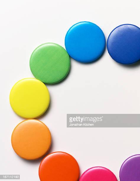 Half circle of coloured badges