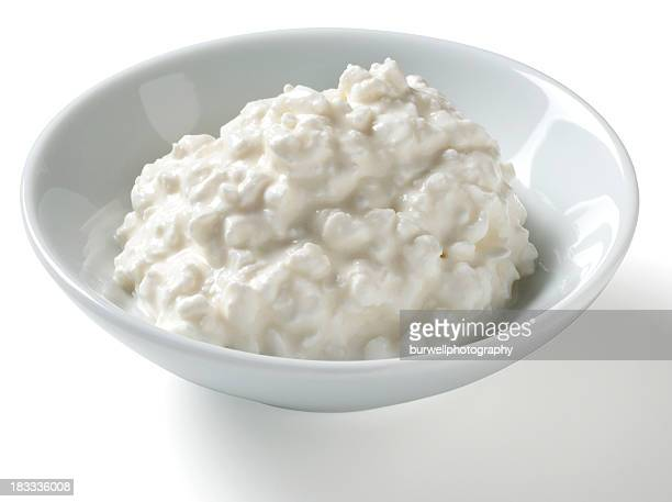 Half Cup serving of Cottage Cheese, white background