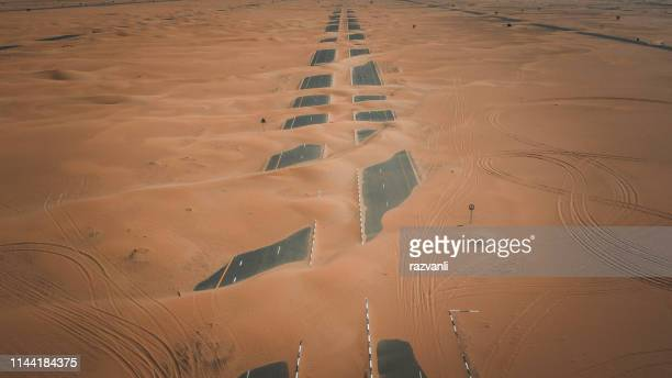 half desert road - gulf countries stock pictures, royalty-free photos & images