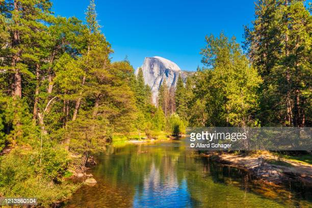 half dome and merced river in yosemite national park usa - september stock pictures, royalty-free photos & images