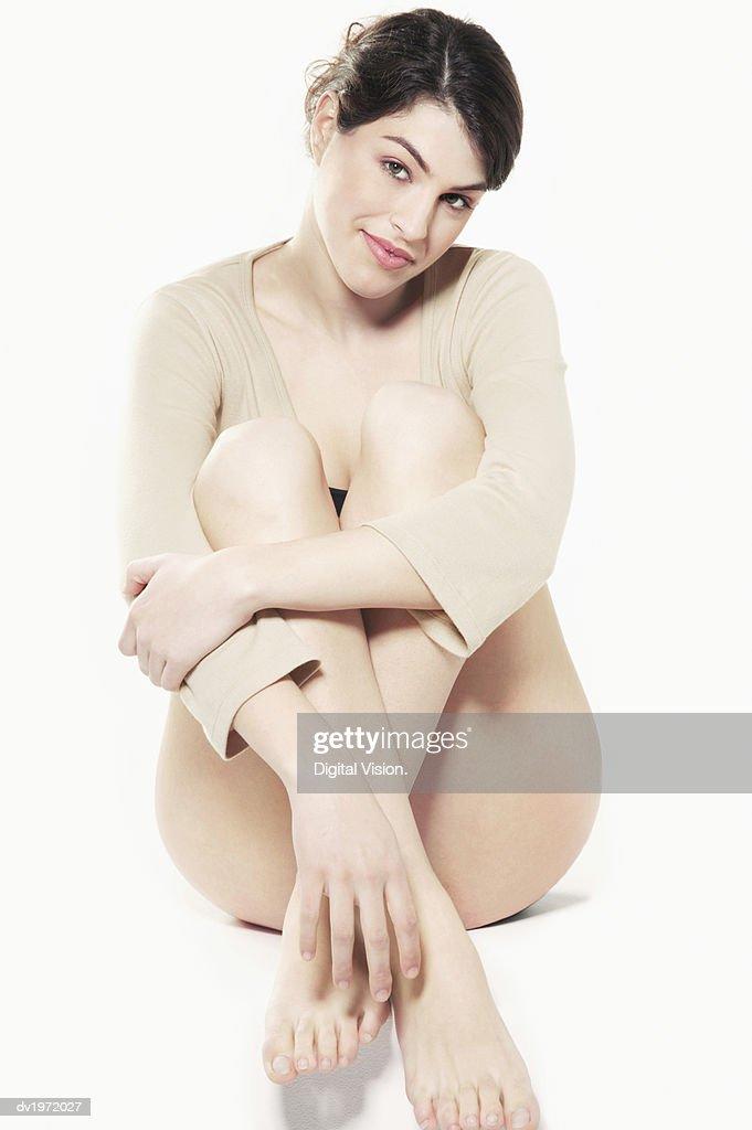 Half Dressed Woman Sitting on Floor, Studio Shot : Stock Photo
