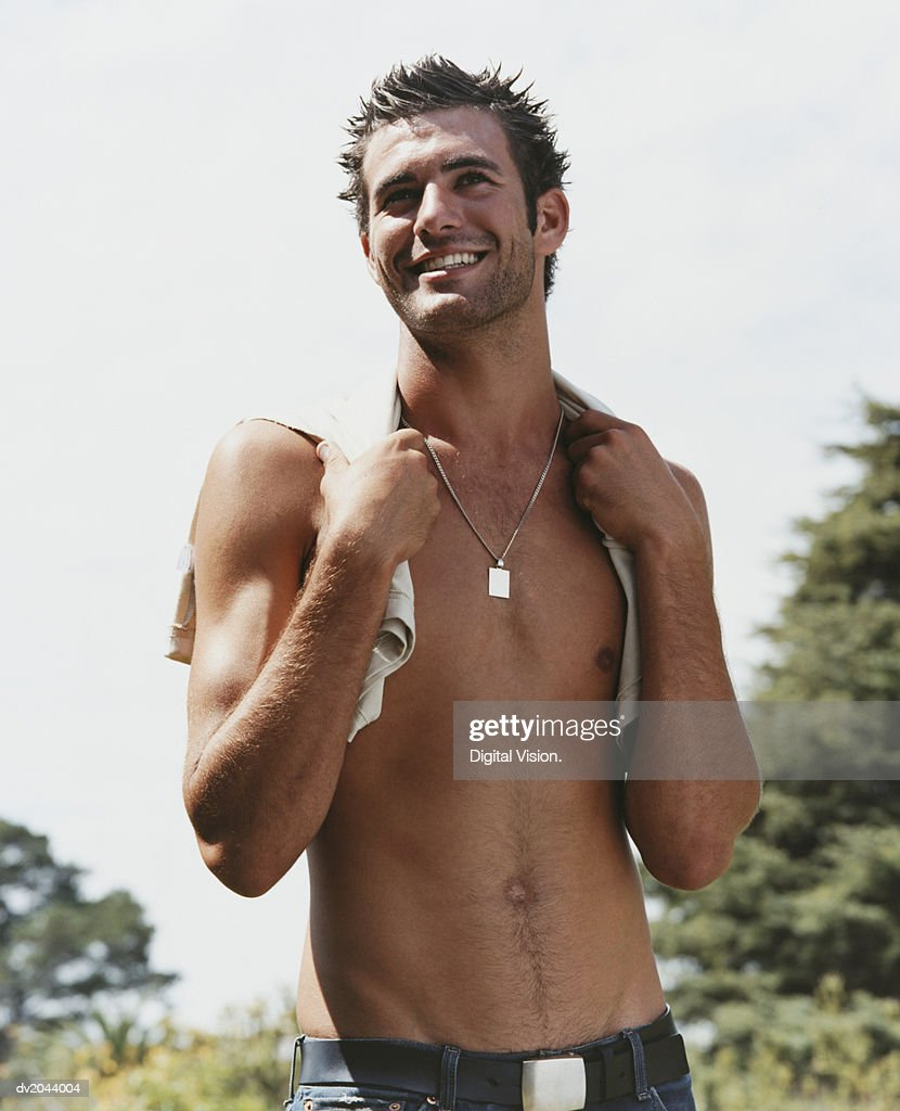 Half Dressed Young Man in the Park : Stock Photo