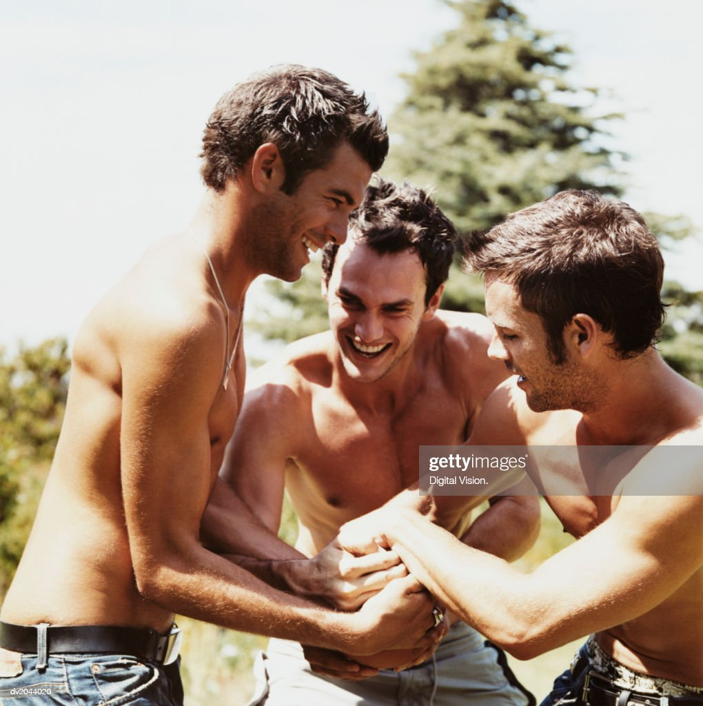 Half Dressed Young Men Bonding in a Garden : Stock Photo