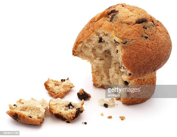 Half eaten chocolate chip muffin isolated on white