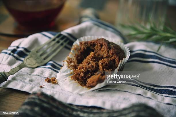 half eaten cupcake - rekha garton stock pictures, royalty-free photos & images