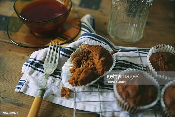 half eaten cupcake with tea - rekha garton stock pictures, royalty-free photos & images
