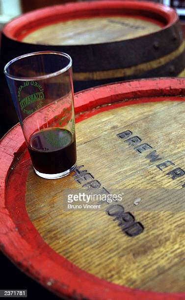 Half empty glass is left on a barrel at the Great British Beer Festival at the Olympia Exhibition Center August 5, 2003 in London, England.