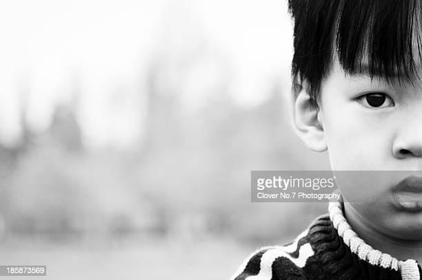 Half face portrait of the little boy.