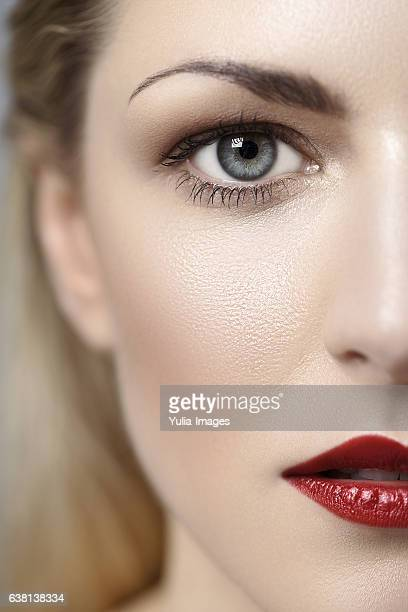 half face with make-up of a pretty young woman - tierkörper stock-fotos und bilder