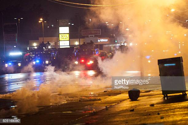 A half hour past midnight and into the curfew police fired tear gas at the protestors to disperse them during a protest for the killing of teenager...