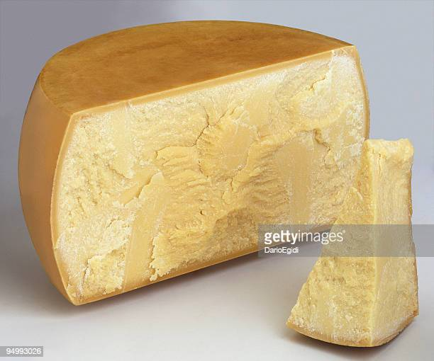 half italian parmesan cheese and a piece - parmesan cheese stock pictures, royalty-free photos & images