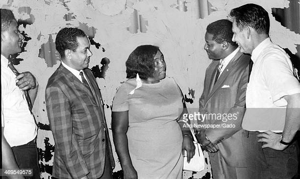 A half length portrait of civil rights leader Fannie Lou Harmer with left to right John Brown director of SEASHA Frank Toland Tuskegee City...