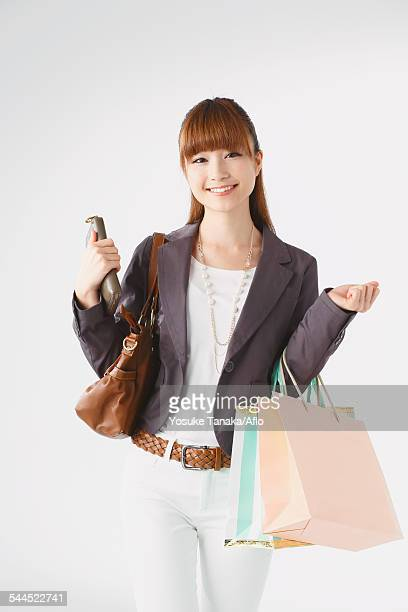 Half length portrait of Japanese young businesswoman against white background