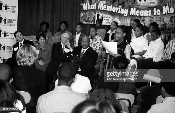 A half length portrait of US Representative Elijah Cummings at an educational event about mentoring surrounded by adults and children Maryland...