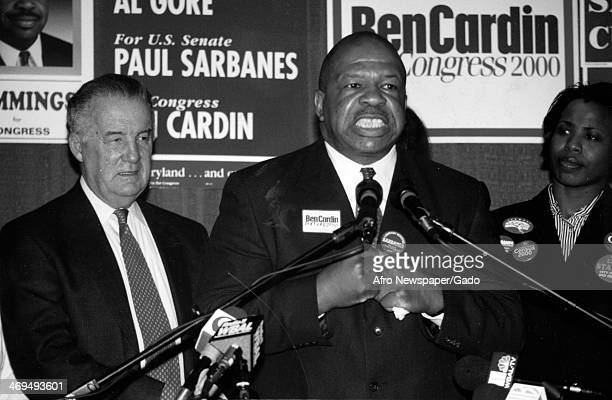 Half length portrait of US Representative Elijah Cummings, flanked by a man and a woman, speaking at the 2000 primary election, Maryland, March 11,...