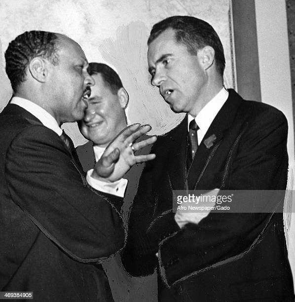 Half length portrait of vice president Richard Nixon talking to another man A third man in the background, June 1, 1955.
