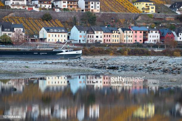 Half loaded cargo ships pass banks and the low water in the River Rhine on November 13 2018 in Lorchhausen Germany Summer heat wave in Germany as...