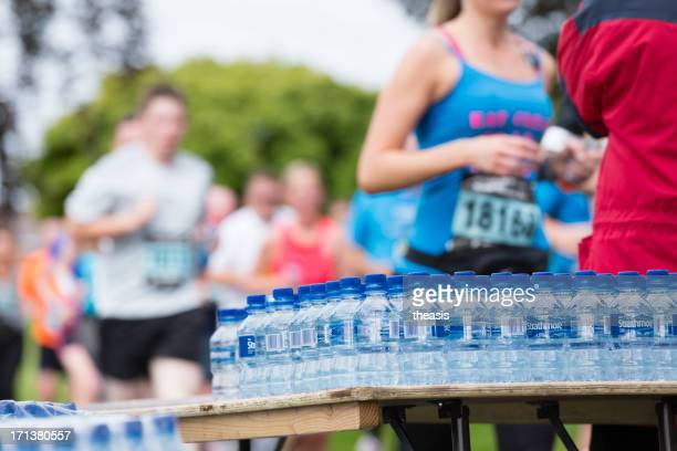 half marathon watering station - theasis stock pictures, royalty-free photos & images