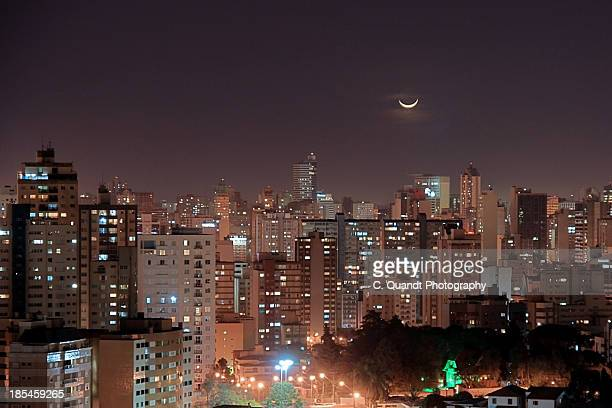 half moon over city skyline - curitiba stock pictures, royalty-free photos & images