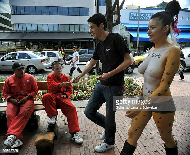 A half naked model with body painted walks on the streets of Bogota to promote the freedom of expression for a Colombian magazine on January 20 2010...