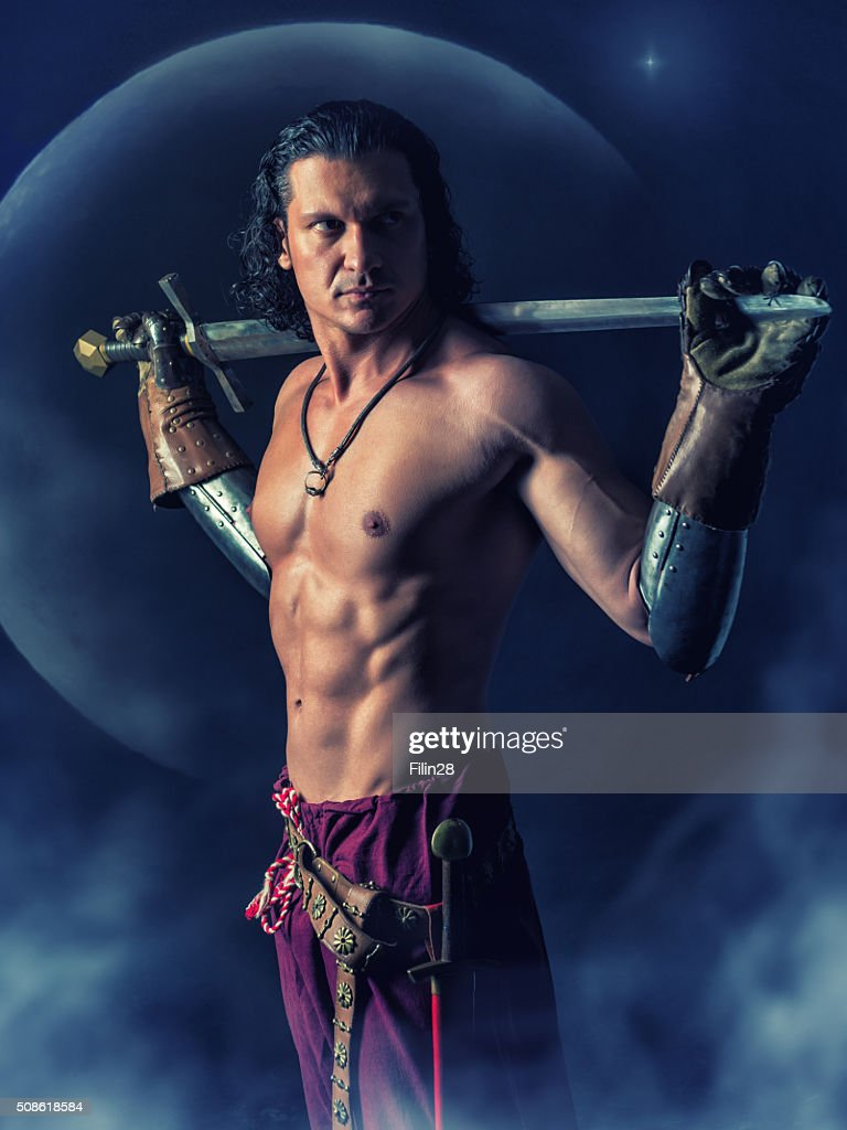 half naked  warrior with a sword in the mystic background : Stock Photo