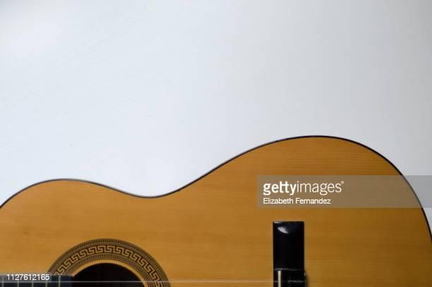 half of a guitar, white background - chitarra classica foto e immagini stock