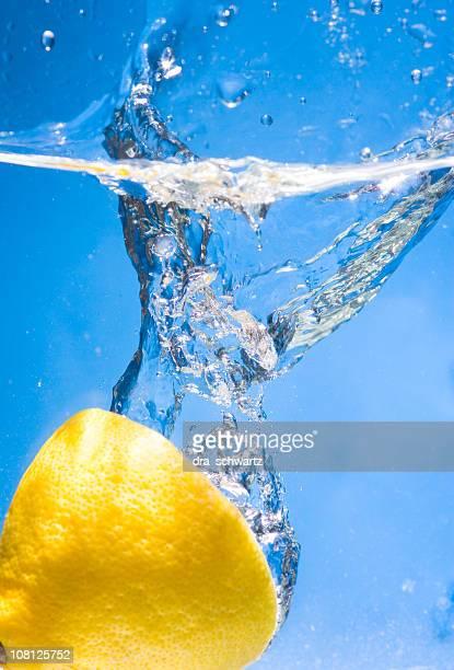 Half of a Lemon Splashing in Water