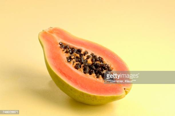 half of a papaya - papaya stock photos and pictures