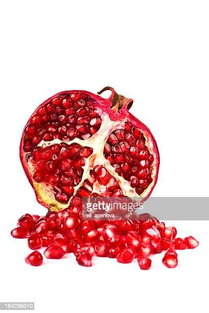 half of a pomegranate on a white background - pomegranate stock pictures, royalty-free photos & images