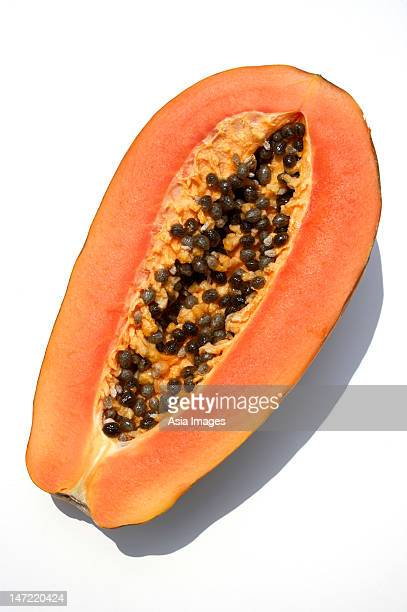 half of papaya - papaya stock photos and pictures