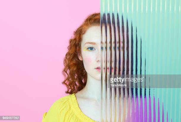 half of woman's face obscured by glass - teilen stock-fotos und bilder