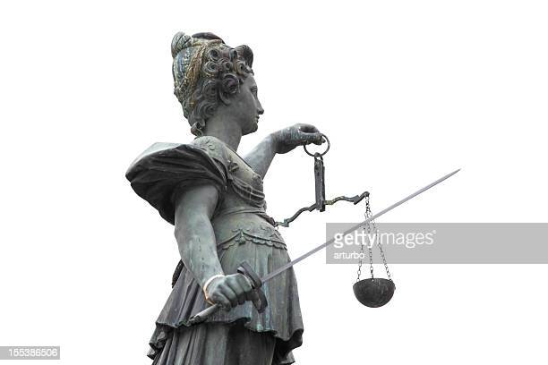 half portrait from right behind of Lady Justice against sky