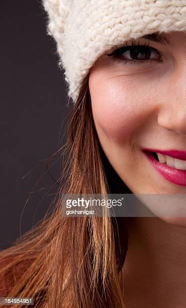 Half portrait of beautiful woman over black background