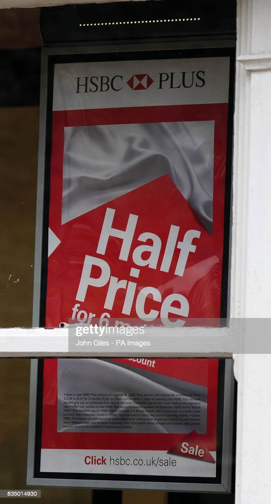 Half price and sale signs in the window of an HSBC bank in Hawes