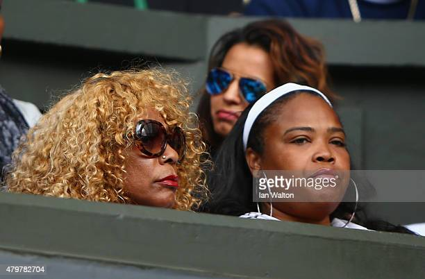 Half sister Isha Price and mother Oracene Price watch Serena Williams of the United States in her Ladies Singles Quarter Final match against Victoria...