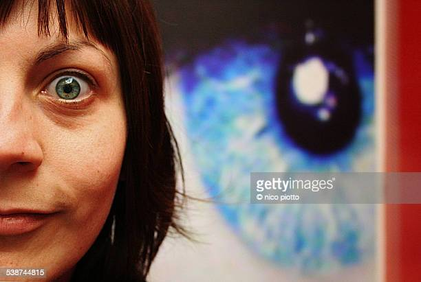 half woman face and big eye in the background - big eyes stock photos and pictures
