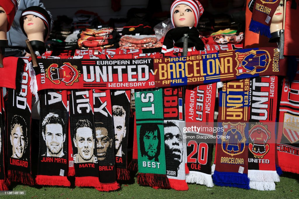 Half-and-half scarves for sale on a souvenir stall ahead of
