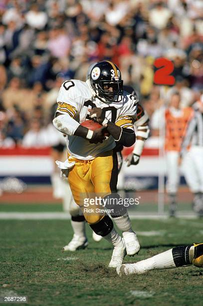 Halfback Frank Pollard of the Pittsburgh Steelers carries the ball during a 1984 NFL game against the Oakland Raiders at the Oakland Coliseum in...