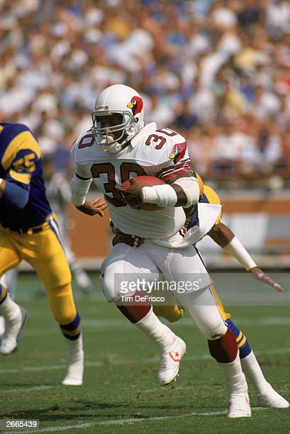 Halfback Stump Mitchell of the Phoenix Cardinals carries the ball during a NFL game on October 2 1988 against the Los Angeles Rams The Cards defeated...