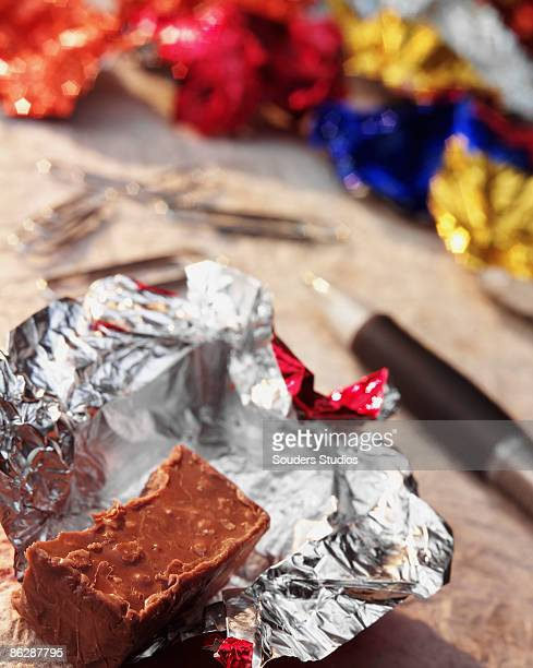half-eaten candy bar - candy wrapper stock photos and pictures