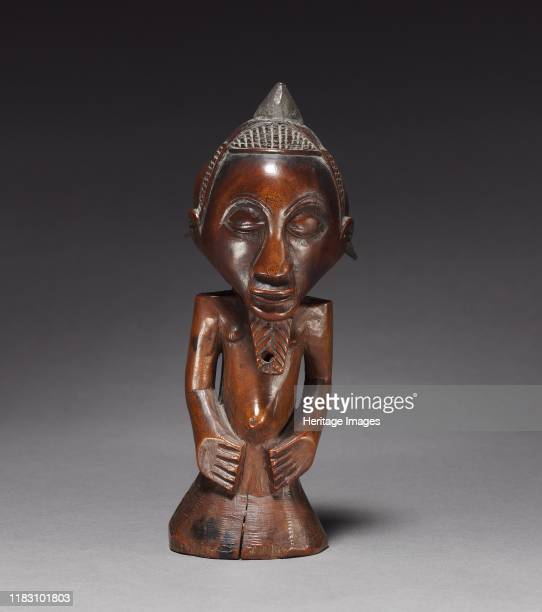 HalfFigure late 1800searly 1900s This torso is believed to be carved in the style of the Kusu people closely related but littleknown neighbors of the...
