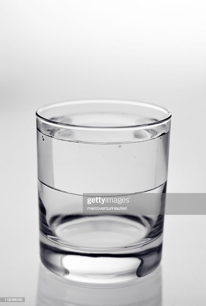 Half-full glass (wrong half), illusion of what it can't be : Stock Photo